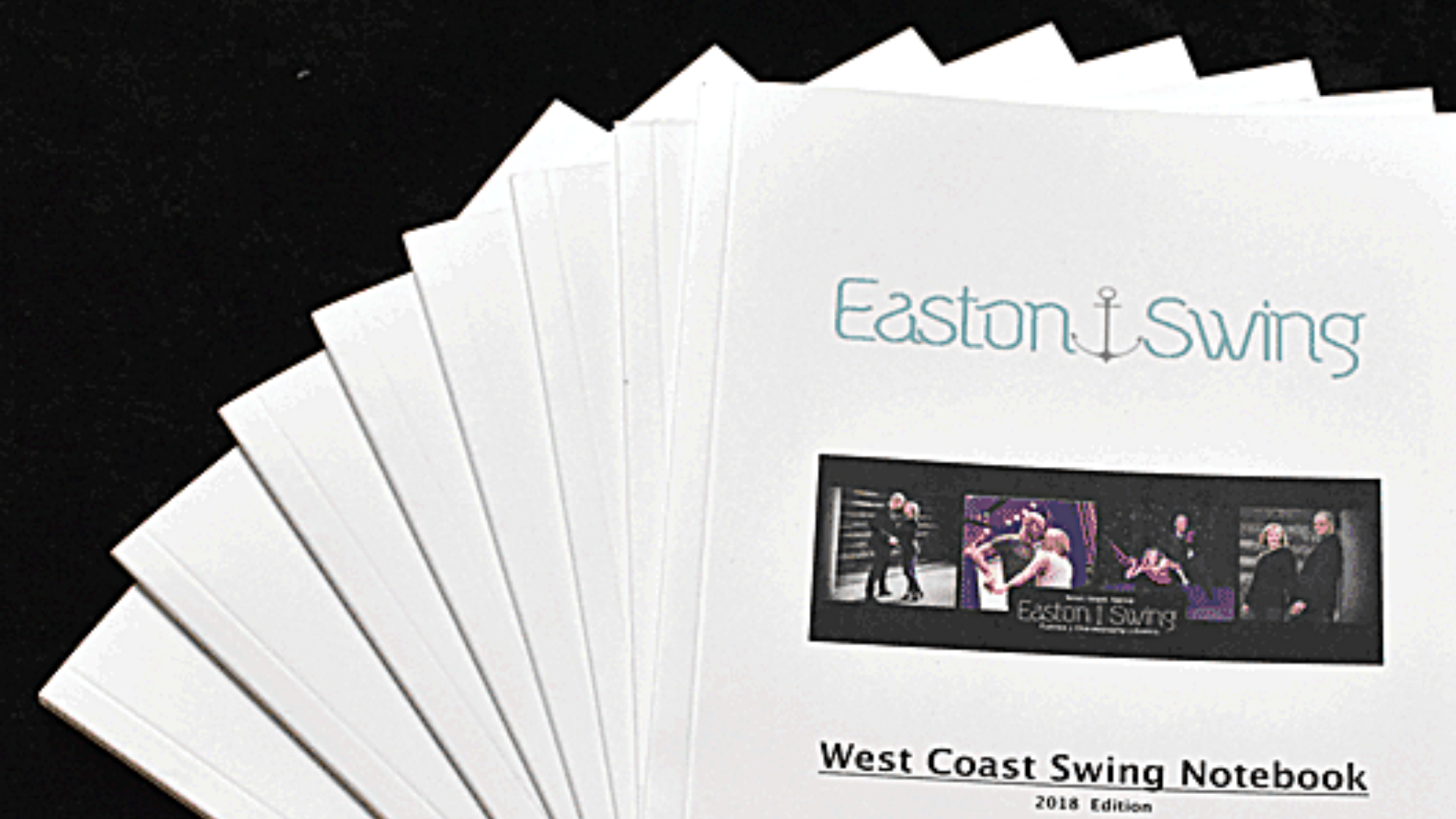 West Coast Swing notebook for Levels 1-3 photographed on a black background