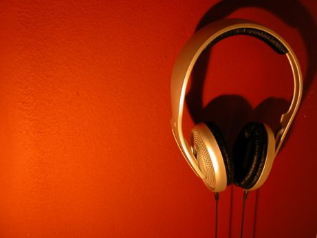 west coast swing music, Red Background with Gold over ear headphones